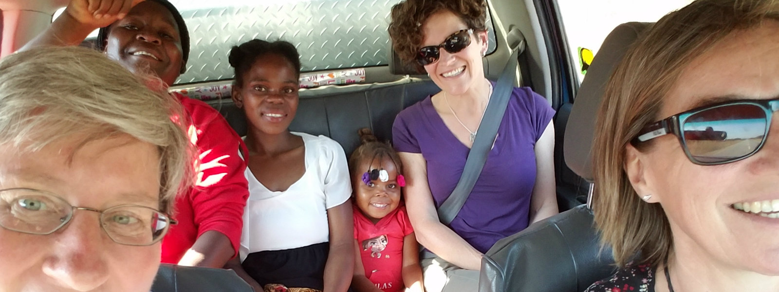 Founder of Hope for Our Sisters an several children riding in car