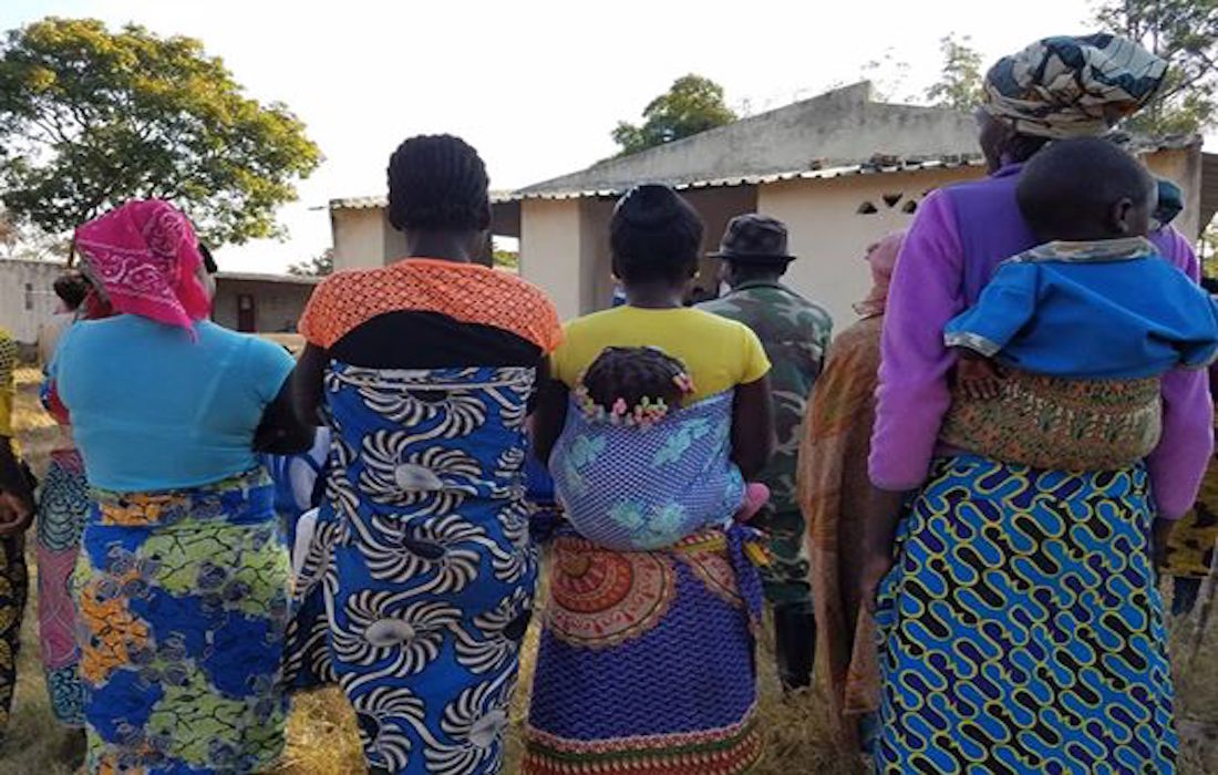 African women walking with babies on their backs, rear view