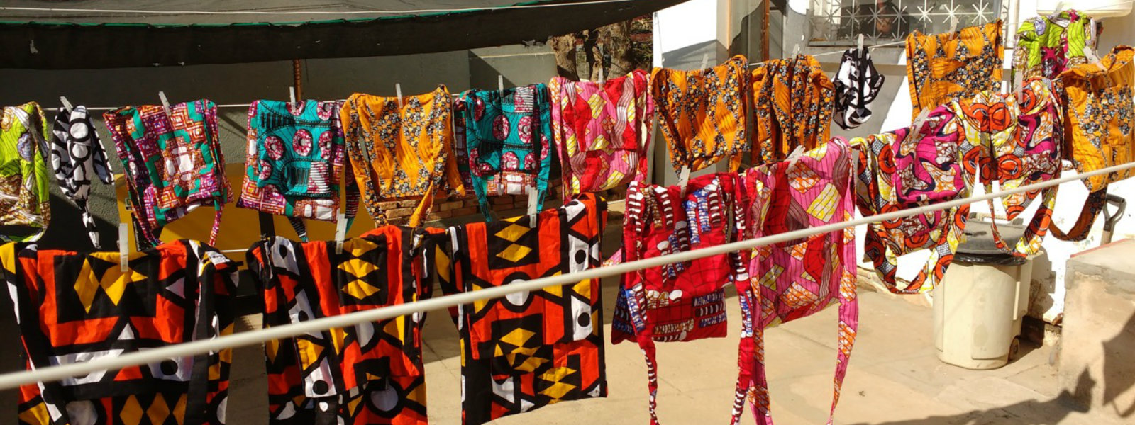 Clotheslines with colorful handmade bags, Hope for Our Sisters