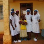 Five African nurses with very young woman and newborn child