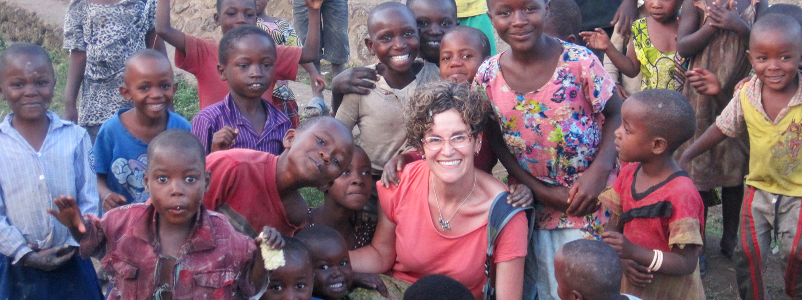 Founder Brooke Sulahian surrounded by local children in Angola
